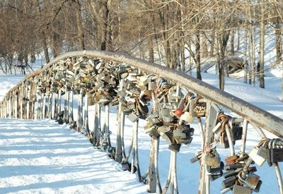 Locks adorn a snow-covered bridge as part of a traditional Russian wedding.