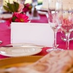 Fuschia pink and gold themed reception place setting.