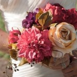 Bride carries her elegant muted rose, violet and gold themed bouquet.