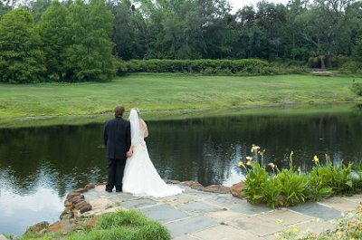 Bride and groom share a quiet moment of reflection after the wedding ceremony.