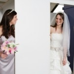 Bride and her maid of honor attend a final dress fitting.