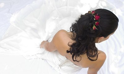 http://www.littleweddingguide.com/images/wedding-hair-with-red-roses.jpg